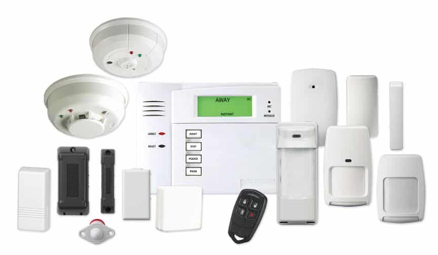 image of a residential alarm system components: smoke and C02 detectors, control panel, motion detectors, cameras and a key fob controller.