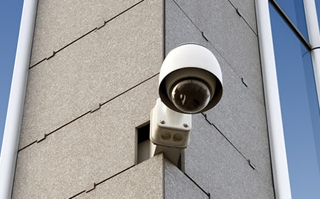 image of an outdoor CCTV camera on the outside of a commercial building