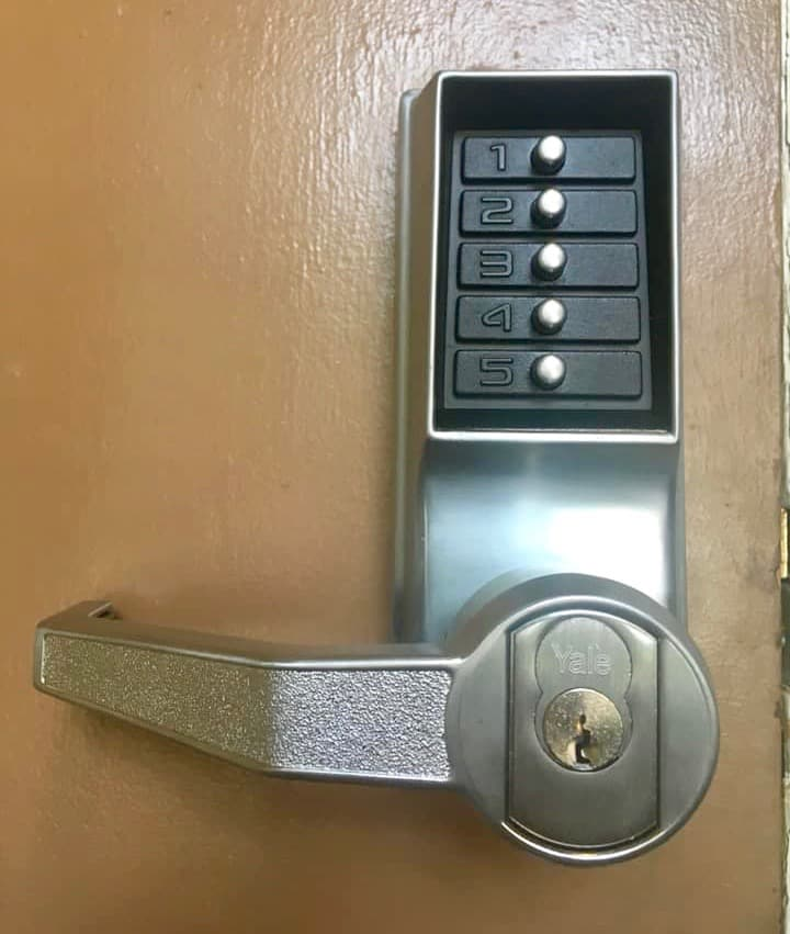 simplex lock with a Yale interchangeable core installed on a wooden door